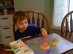 Toddler decorating cookies