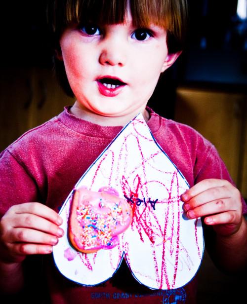 Kid holding a valentine