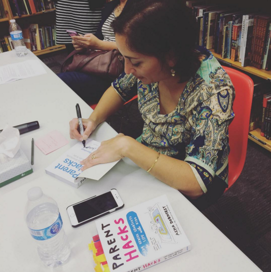 Asha Dornfest signing Parent Hacks at Powell's
