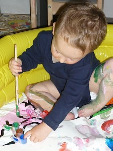 Let toddlers finger paint inside a wading pool