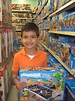 "Take digital photos at the toy store to create a photographic ""Santa list"""
