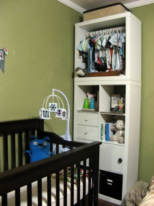 No closet in baby's room? Hack an IKEA Expedit bookshelf.