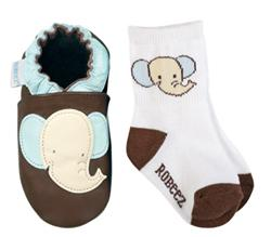 Rubber band pant legs over sockless baby feet