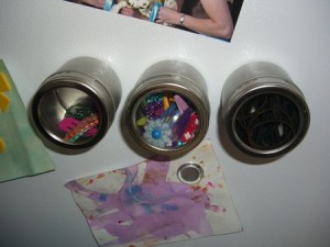 Keep hair clips organized in magnetic spice canisters