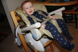 Reclining high chair makes for hands-free snot sucking and medicine-giving