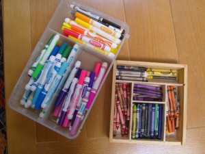 Organize crayons and markers by color family