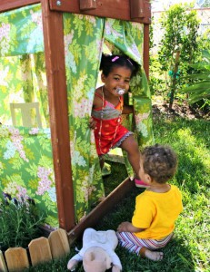Backyard clubhouse: staple oilcloth to a play structure