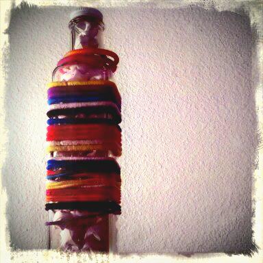 Glass bottle hair band holder