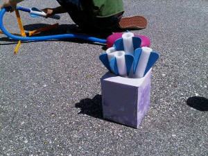 Tissue box as stomp rocket storage system