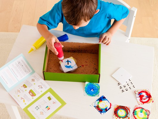 Kiwi Crate: Spin art dreidel craft from Handmade Hanukkah gift crate