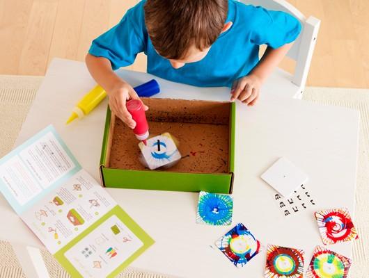 Kiwi Crate: Spin art dreidel craft from Handmade Hanukkah gift crate