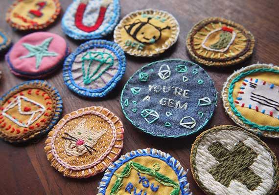 Homemade merit badges. Photo credit: Etsy/Julie Schneider