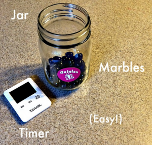 Use a marble jar and a timer to manage screen time