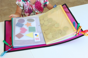 Turn a binder + pencil pouches into a portable travel play kit